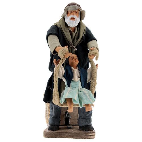 Avô brincando com neta movimento presépio napolitano com figuras altura média 14 cm 1