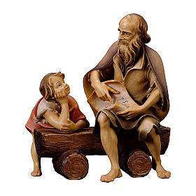 Belén Val Gardena: Anciano en un banco con niño para belén Original madera pintada en Val Gardena 10 cm de altura media