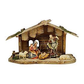 Sacra famiglia nella casa con pecore presepe Original legno dipinto in Valgardena 10 cm s1