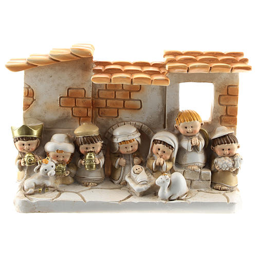 Nativity scene with hut made of resin with 10 characters 15x10 cm, children's line 1