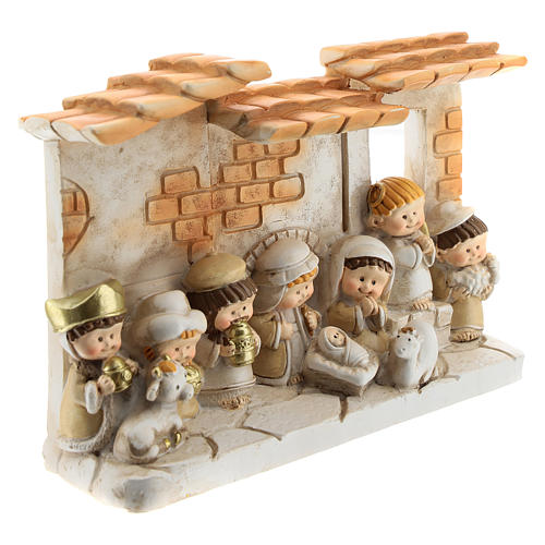 Nativity scene with hut made of resin with 10 characters 15x10 cm, children's line 3