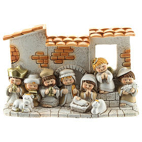 Nativity scene with hut made of resin with 10 characters 10x15 cm, children's line s1