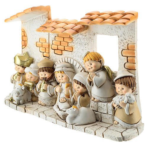 Nativity scene with hut made of resin with 10 characters 10x15 cm, children's line 2
