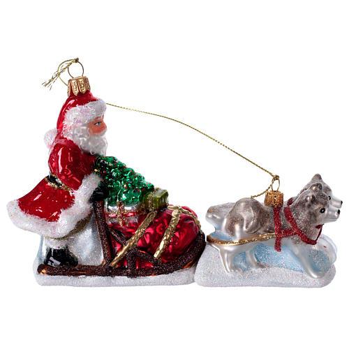 Blown glass Christmas ornament, Santa Claus dog sledding 1