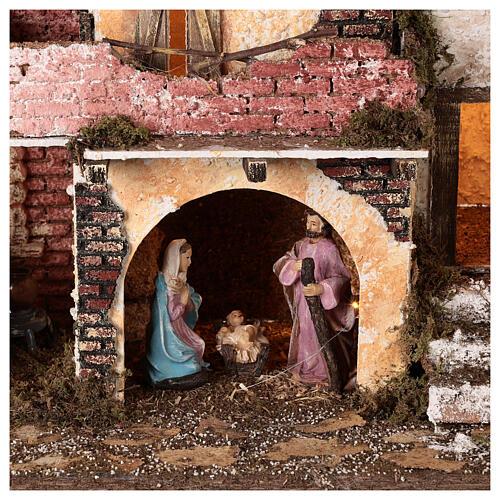 Borgo portico muratura luci e fuoco 40x45x30 cm Natività 10 cm 2