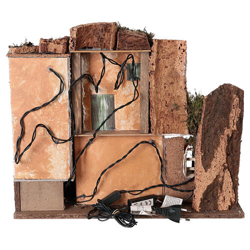 Borgo portico muratura luci e fuoco 40x45x30 cm Natività 10 cm 5