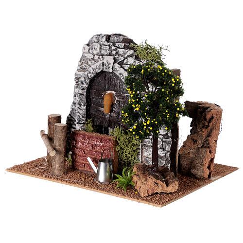 Fontaine en plâtre avec arbre pour crèche 20x15x15 cm 2