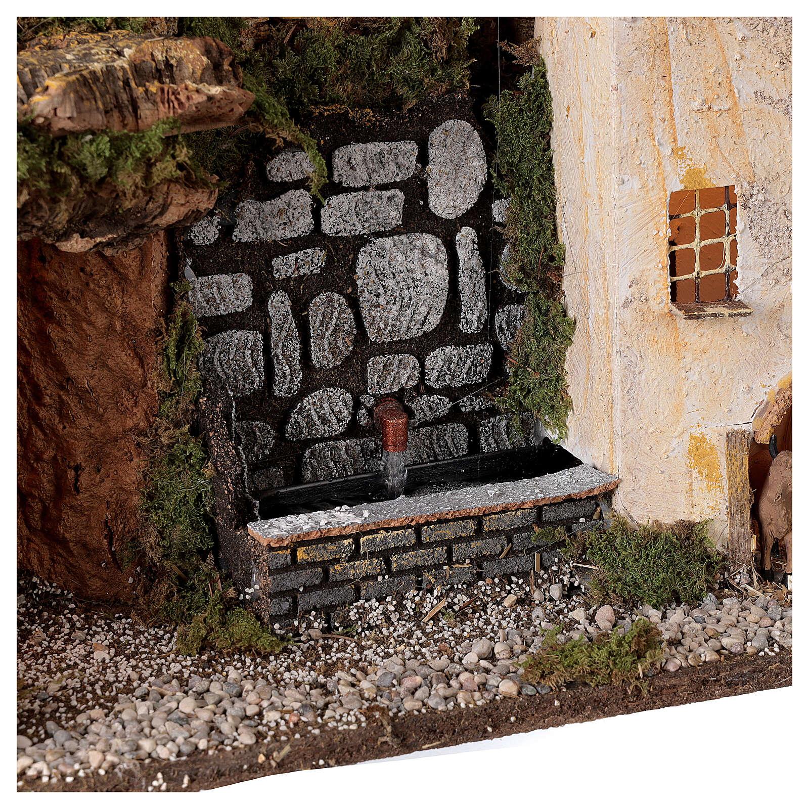 Aldeia com luzes e fontanário com bomba de água para presépio com figuras de altura média 10-12 cm; medidas: 31x45x20 cm 4