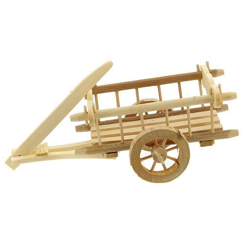 Carretinha em miniatura de madeira clara com engate para presépio com figuras de altura média 12 cm; medidas: 8x16,5x7,5 cm 1