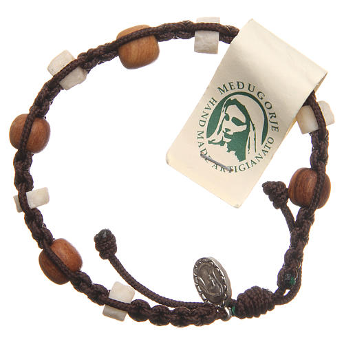Bracelet in olive wood with grains in white Medjugorje stone and brown cord 1