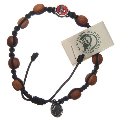 Medjugorje single decade rosary bracelet with Holy Spirit medallions, olive wood grains and black rope 1