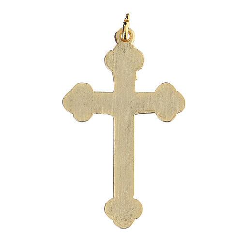 Cruz colgante dorada fondo verde 2