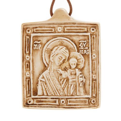 Medalla de piedra de la Virgen con el Niño Belén 1