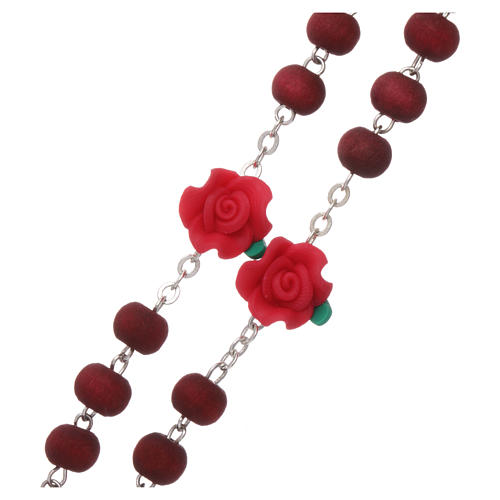 Rosary in scented wood with 3x5 mm grains and rose-shaped grains 3