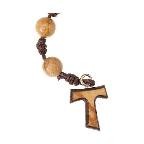 Dziesiątka różańca drewno oliwne na sznurku Tau supełki 2