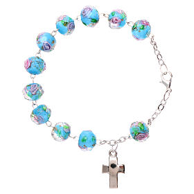 Rosary bracelet with 5x5 mm faceted light blue grains and roses, chain with fastener s2
