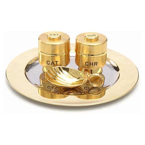 Holy Oils: set with brass stocks and a baptismal shell 1