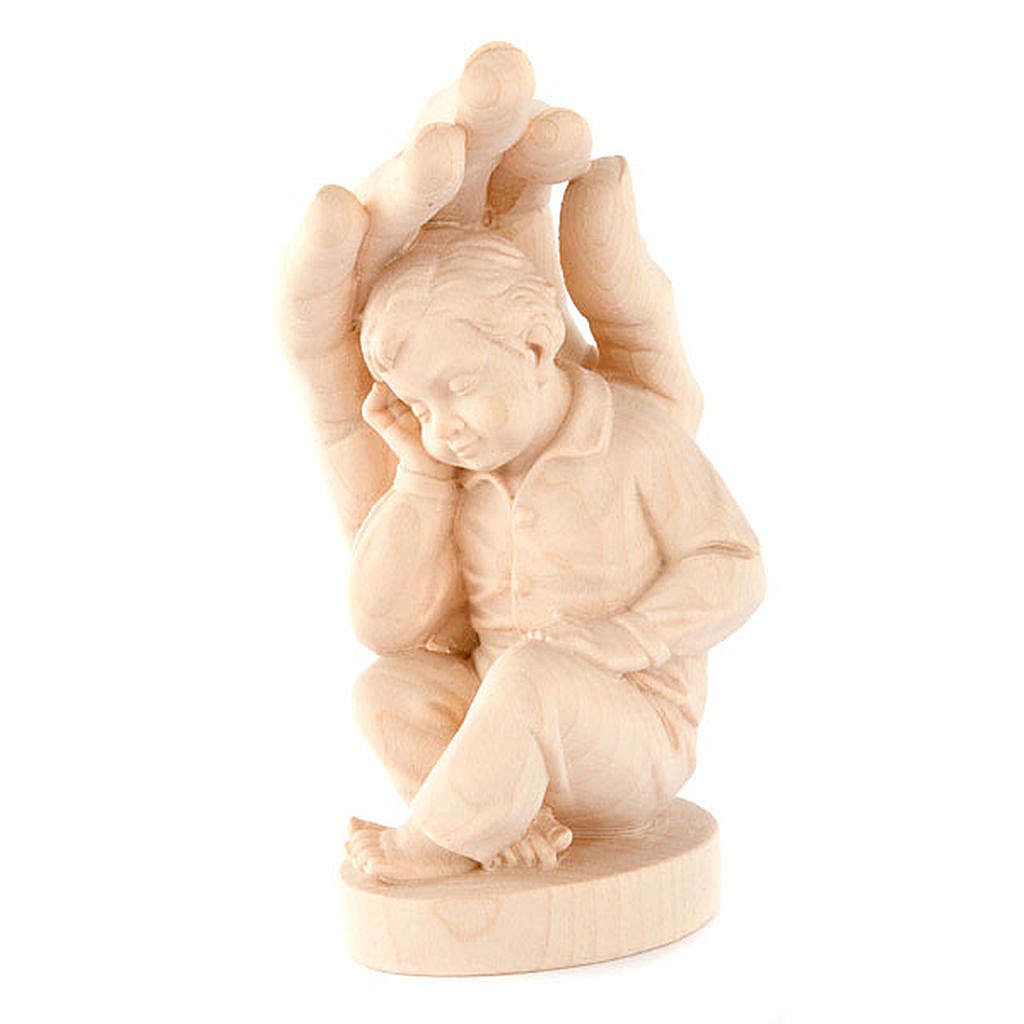 Hand of God with baby boy in wood 4