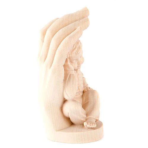 Hand of God with baby boy in wood 2