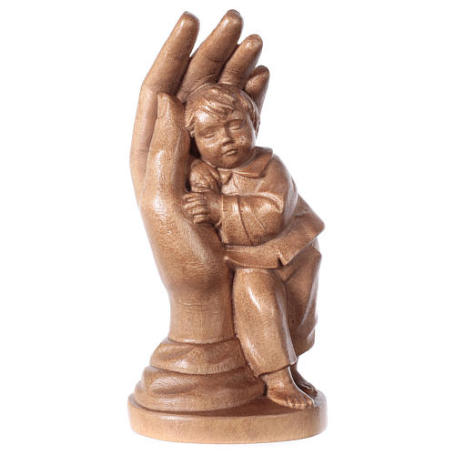 Protective hand with young boy in patinated Valgardena wood 1