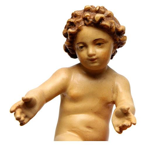 Enfant Jésus en bois coloré avec nuances de brun 2