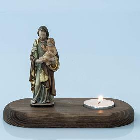 Saint Joseph with votive candle s2