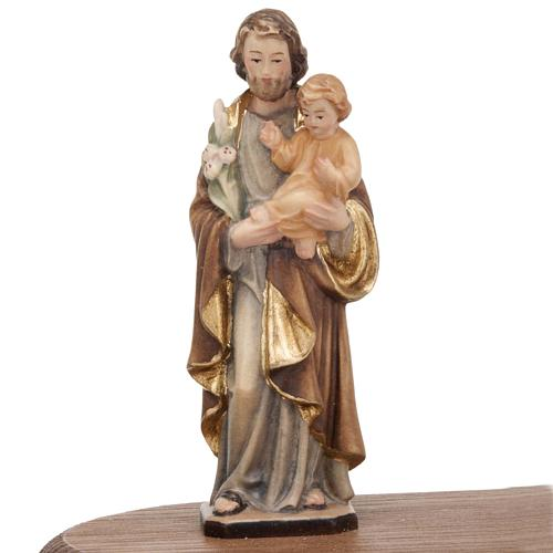 Saint Joseph with votive candle 3
