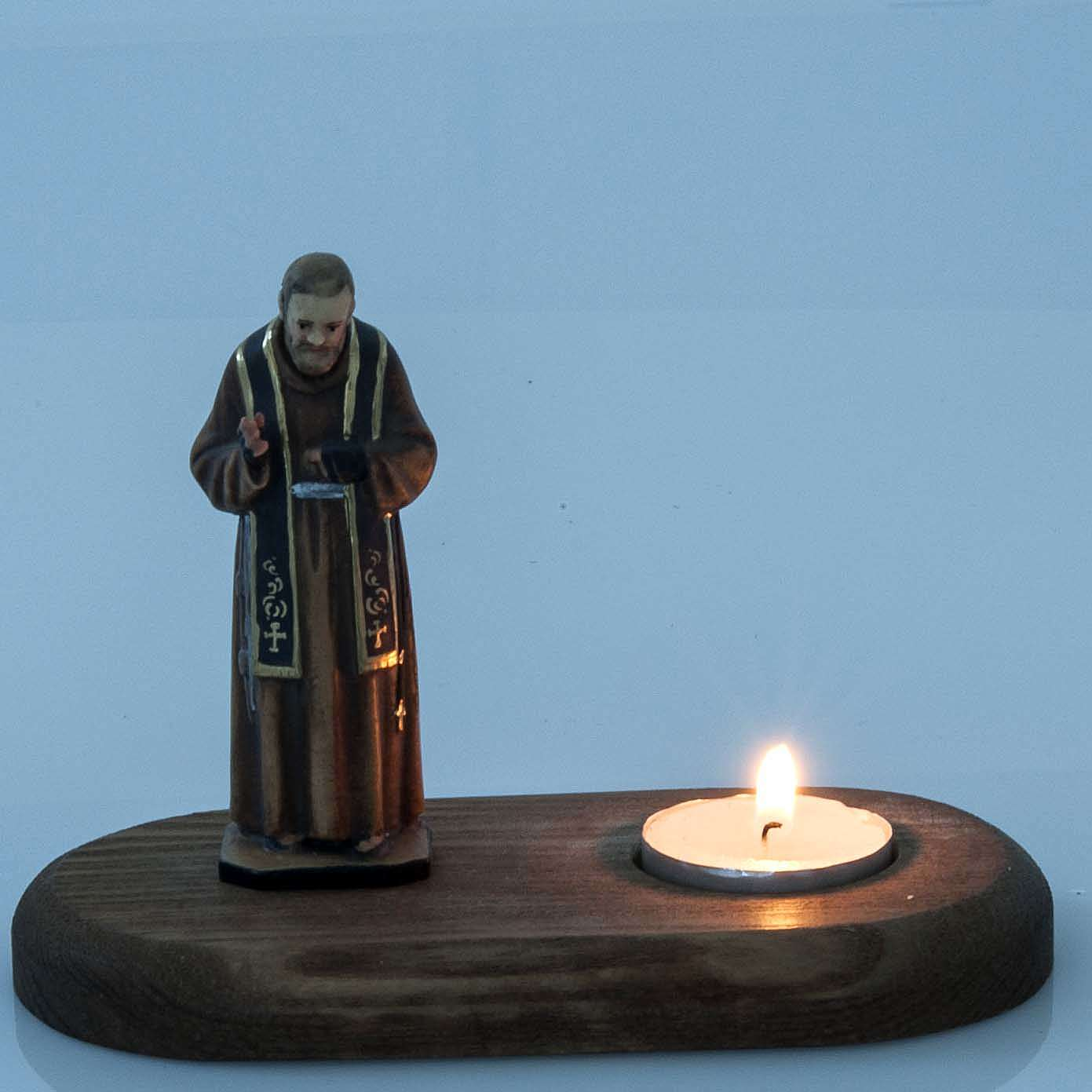 Father Pius with votive candle 3