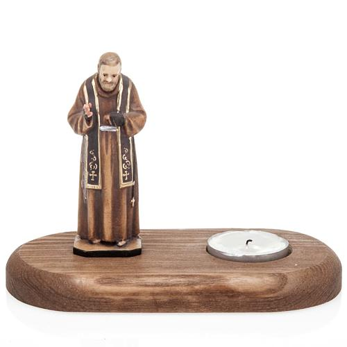 Father Pius with votive candle 1