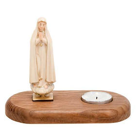 The Virgin of Fatima with votive candle s1