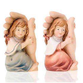Imágenes de Madera Pintada: Mano de Dios acoge niña