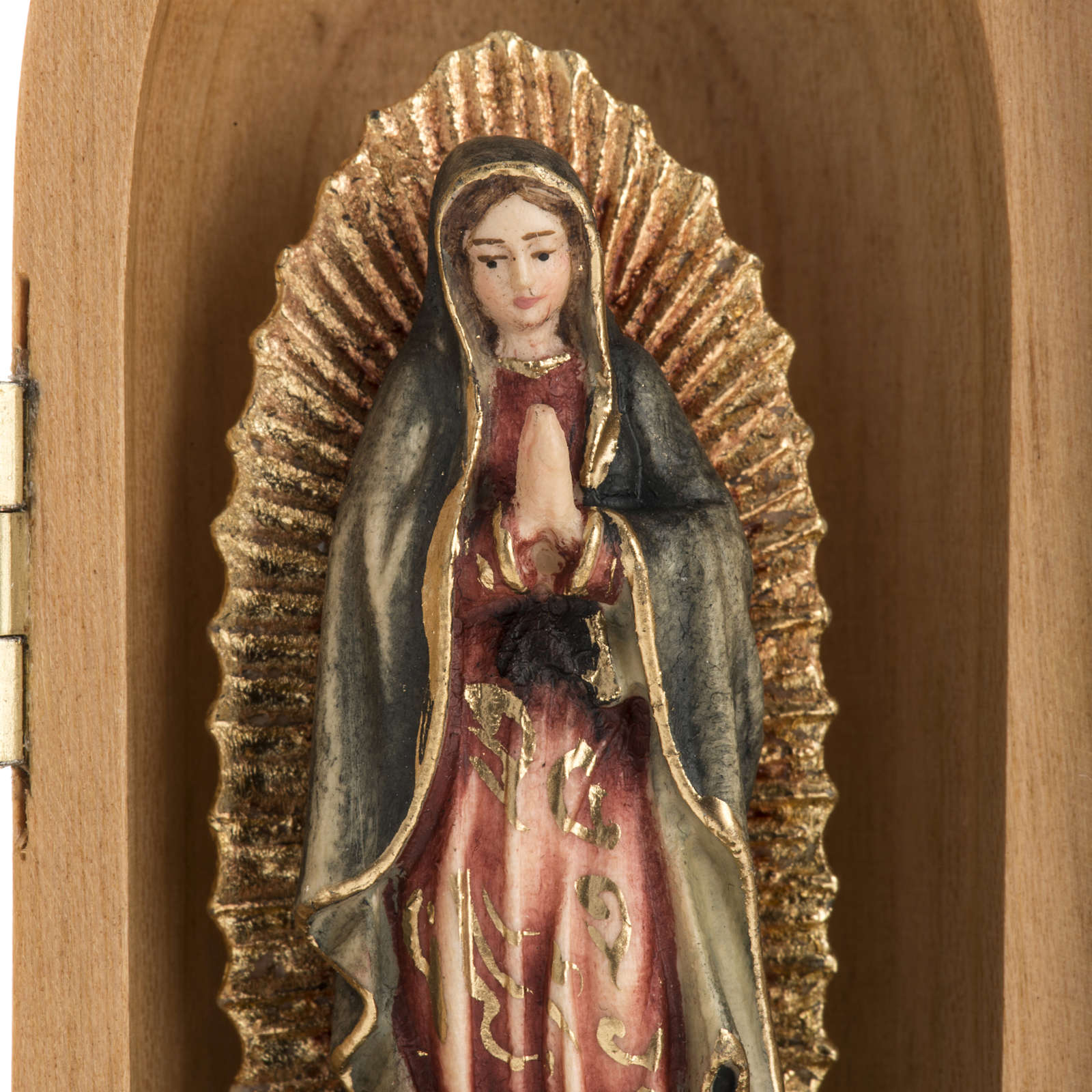 Our Lady of Guadalupe wooden statue painted in niche 4