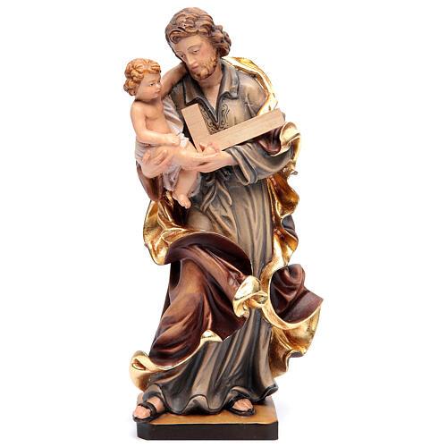 Estatua San José con el Niño Jesús de madera pintada