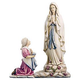 Imágenes de Madera Pintada: Estatua de la Virgen de Lourdes con Bernadette de madera pintada de la Val Gardena