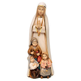 Hand painted wooden statues: Our Lady of Fatima stylized in natural wood of Valgardena
