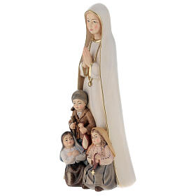 Our Lady of Fatima stylized in natural wood of Valgardena s4
