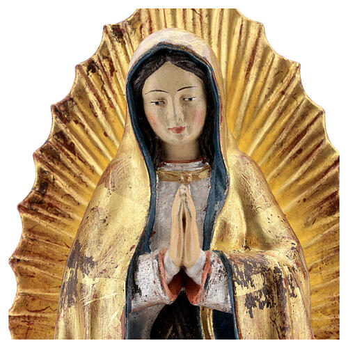 Our Lady of Guadalupe in wood of Valgardena finished in antique pure gold with silver mantle