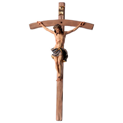 Crucifix in wood, curved cross and blue garment, Val Gardena 1