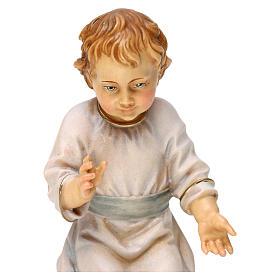 Gesù bambino seduto su culla legno Valgardena s2