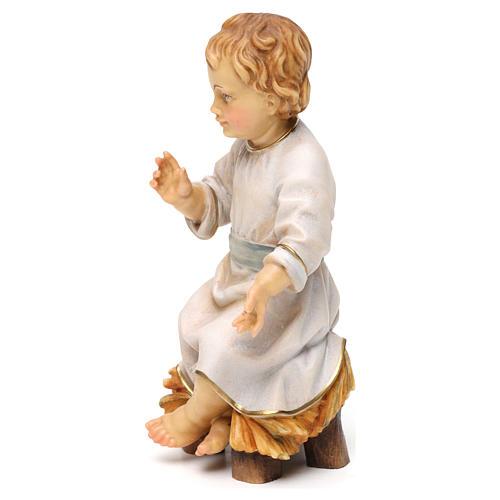 Gesù bambino seduto su culla legno Valgardena 3