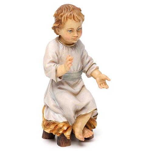 Gesù bambino seduto su culla legno Valgardena 4
