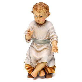 Hand painted wooden statues: Child Jesus sitting on manger, in Valgardena wood