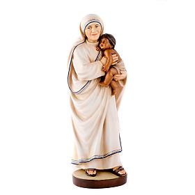 Statuen aus bemalten Holz: Mutter Theresa aus Calcutta