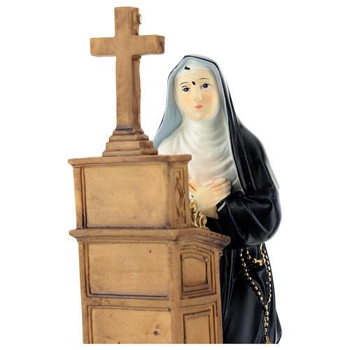 Santa Rita oración de rodillas estatua resina 20 cm