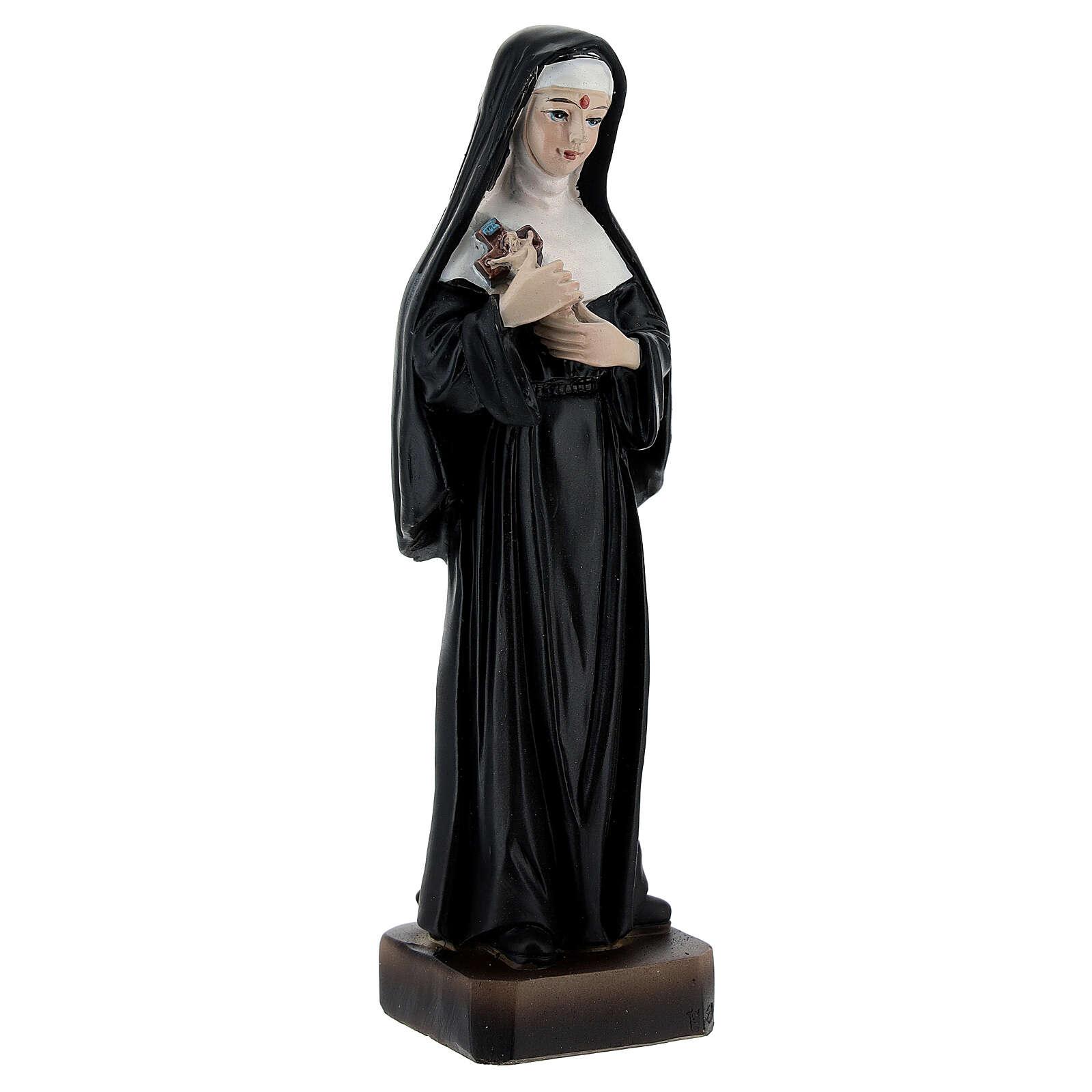 Linda imagem de resina que representa Santa Rita de Cássia, padroeira das causas impossíveis, com o crucifixo nas mãos e o estigma na testa 4
