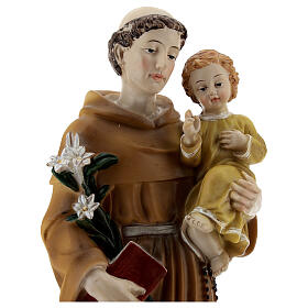 Statuette of St. Anthony with Baby resin yellow clothes 30 cm.