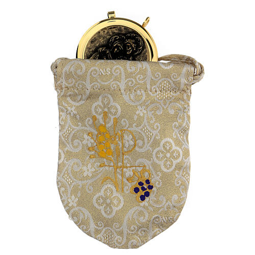Golden burse with white decorations and a 2 in pyx 1