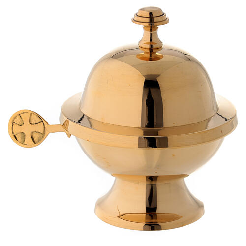 Round shuttle with golden brass spoon 1