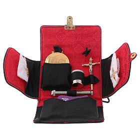 Pyx set with black leather case, snap closure and shoulder strap s1